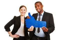 Man and woman holding blue thumbs up Royalty Free Stock Photos