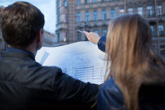 Man and woman holding blueprint Royalty Free Stock Images