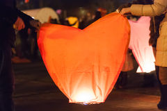 Man and woman holding a Chinese lantern Royalty Free Stock Photography