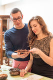 Man and woman holding chocolate truffle Royalty Free Stock Images