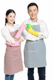 Man and woman holding cleaning supplies Royalty Free Stock Image