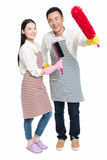 Man and woman holding cleaning supplies Royalty Free Stock Photography