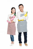Man and woman holding cleaning supplies Royalty Free Stock Photos