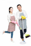 Man and woman holding cleaning supplies Stock Image