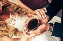 Man and woman holding coffee cup in the hands, closeup top view stock photos