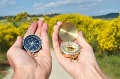 Man and woman holding compasses Royalty Free Stock Photography