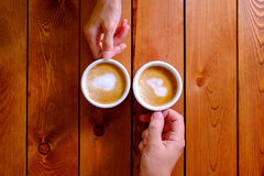 Man and woman holding a cup of coffee in the cafe Royalty Free Stock Photo