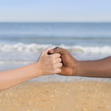 Man and woman holding each other's hand (symbol of love and diversity) Royalty Free Stock Images