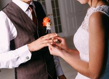 Man and woman holding a flower stock photography