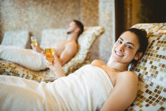 Man and woman holding glasses of champagne Stock Photography