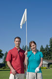 Man and Woman Holding Golf Pin - Vertical Stock Photo