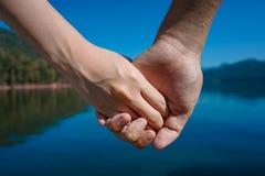 Man & woman holding hand stock photo