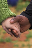 Man & Woman holding hands. Couple holding hands outdoors Royalty Free Stock Photo