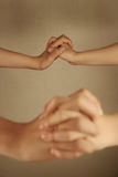 Man and woman holding hands Royalty Free Stock Image
