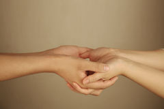 Man and woman holding hands Stock Photos