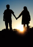 Man and woman holding hands on the background of a beautiful sun. Set Royalty Free Stock Photo