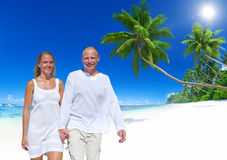 Man and Woman Holding Hands by the Beach Stock Photo