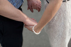 Man and woman holding hands. City summer daylight Royalty Free Stock Photos