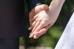 Man and woman holding hands closeup Stock Images