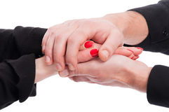 Man and woman holding hands in closeup Royalty Free Stock Images
