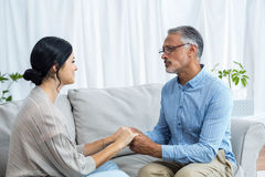 Man and woman holding hands Stock Photography