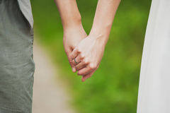 Man and woman holding hands. young couple in love standing toget Royalty Free Stock Images