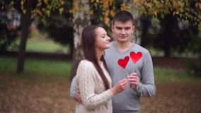 Man and woman are holding a heart. On Valentine's Day stock video footage