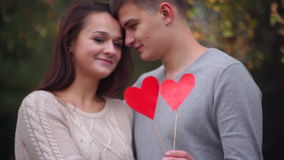 Man and woman are holding a heart stock footage