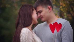 Man and woman are holding a heart. On Valentine's Day stock video