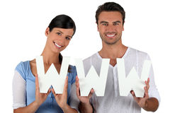 Man and woman holding letters Stock Image