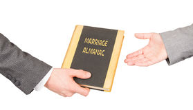 Man and woman holding a marriage almanac. Saving her marriage Stock Photography