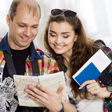 Man and a woman holding a passport .Look at the map, direction of study. Europeans. Gathered in a guided tour.Honeymoon Stock Photo