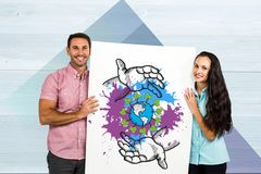 Man and woman holding placard with save earth concept. Digital composite of Man and women holding placard with save earth concept Royalty Free Stock Images