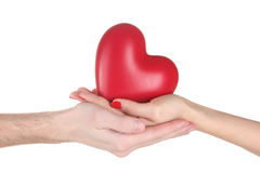 Man and woman holding red heart in hands Royalty Free Stock Photos
