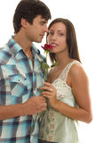 Man Woman holding single red rose Royalty Free Stock Image