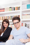 Man and woman in the house with lots of books Royalty Free Stock Photo