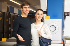 Man and woman at household appliances section Stock Images