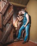 Man and woman hug in the door Stock Image