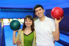 Man and woman hug and in free hand hold ball stock photography
