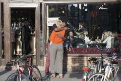 Man and woman hug outside bar Stock Photos