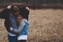 Man and Woman Hugging on Brown Field Royalty Free Stock Photo