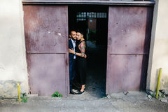 Man and woman hugging in the doorway Stock Photo