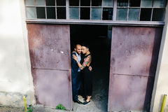 Man and woman hugging in the doorway Stock Photography