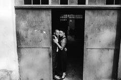 Man and woman hugging in the doorway Stock Image