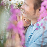 Man and a woman hugging in flower field. Royalty Free Stock Photos