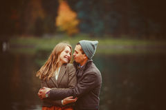 The man and woman hugging near lake Royalty Free Stock Photos