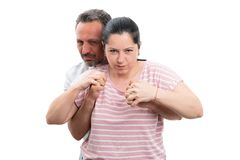 Man and woman hugging and showing fists. Man and women couple making angry expression hugging and showing fists isolated on white studio background royalty free stock photo