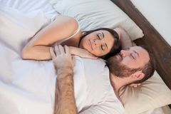 Man and woman, husband and wife woke up in the morning after sleep stock photo