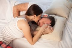 Man and woman, husband and wife woke up in the morning after sleep royalty free stock images