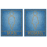 Man and woman icon. Brown stitching on denim background Stock Photo